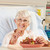 senior female patient eating grapes in hospital bed stock photo © monkey_business