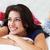 vrouw · ontspannen · bed · pyjama · vrouwen - stockfoto © monkey_business
