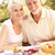 senior couple enjoying meal in garden stock photo © monkey_business