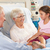 granddaughter visiting grandmother in hospital bed stock photo © monkey_business