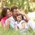 famiglia · seduta · lungo · erba · parco · donna - foto d'archivio © monkey_business
