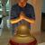 senior chinese man praying to statue of buddha at home stock photo © monkey_business