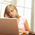 worried looking teenage girl using laptop at home stock photo © monkey_business