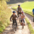 young parents with children ride bikes in park stock photo © monkey_business