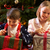 Children Opening Christmas Present In Front Of Tree stock photo © monkey_business