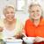 senior · vrouwen · verzorger · genieten · maaltijd · home - stockfoto © monkey_business