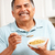 senior man eating cereal stock photo © monkey_business