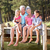 senior couple sitting by lake with grandchildren stock photo © monkey_business