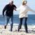 para · uruchomiony · plaży · trzymając · się · za · ręce · uśmiechnięty · człowiek - zdjęcia stock © monkey_business