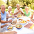 extended family enjoying meal in garden stock photo © monkey_business