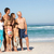 three generation family on holiday walking along beach stock photo © monkey_business