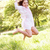 young girl jumping in summer field stock photo © monkey_business
