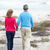 senior couple walking by the sea stock photo © monkey_business