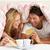 couple snuggled under duvet eating breakfast stock photo © monkey_business