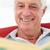 starszy · człowiek · czytania · książki · krzesło · portret - zdjęcia stock © monkey_business