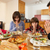 Family Saying Grace Before Eating Lunch Together In Kitchen stock photo © monkey_business