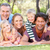 extended family group relaxing in park together stock photo © monkey_business