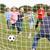 barátok · játszik · futball · égbolt · sport · természet - stock fotó © monkey_business