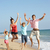 portrait of family on beach holiday jumping in air stock photo © monkey_business