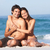 young couple relaxing on beach wearing swimwear stock photo © monkey_business