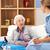 uk nurse visiting senior woman at home stock photo © monkey_business