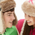 teenage couple in snow wearing fur hats stock photo © monkey_business