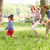 parents playing exciting adventure game with children in summer stock photo © monkey_business