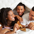 family enjoying breakfast in bed stock photo © monkey_business