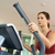 woman on cross trainer machine in gym stock photo © monkey_business