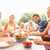 extended family parents grandparents and children eating outd stock photo © monkey_business