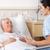 看護 · 患者 · 座って · ベッド · 病院用ベッド · 一緒に - ストックフォト © monkey_business