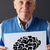 senior man holding ink drawing of brain stock photo © monkey_business