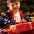 Young Boy Opening Christmas Present In Front Of Tree stock photo © monkey_business