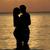 silhouet · liefhebbend · paar · strand · permanente · hemel - stockfoto © monkey_business