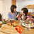 Family Having Argument Whilst Eating Lunch Together In Kitchen stock photo © monkey_business