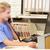 pielęgniarki · posiedzenia · komputera · recepcji · szczęśliwy · szpitala - zdjęcia stock © monkey_business