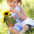 young girl sitting in summer field holding sunflower stock photo © monkey_business