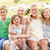 grandparents and grandchildren relaxing in garden stock photo © monkey_business