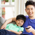 chinese father and son sitting and watching tv on sofa together stock photo © monkey_business