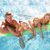 family outside relaxing in swimming pool stock photo © monkey_business