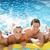 risonho · menina · ar · colchão · jovem · piscina - foto stock © monkey_business