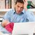 stressed father with newborn baby working from home using laptop stock photo © monkey_business