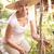 kıdemli · kadın · rahatlatıcı · bahçe · mutlu · kişi - stok fotoğraf © monkey_business