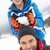 young boy about to drop snowball on fathers head stock photo © monkey_business