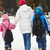 mother walking two children to school along snowy street in ski stock photo © monkey_business