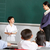 pupil and teacher standing by blackboard in chinese school class stock photo © monkey_business