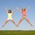 sorridente · mulheres · jovens · saltando · ar · férias · de · verão · viajar - foto stock © monkey_business