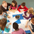 overhead view of schoolchildren working together at desk with te stock photo © monkey_business