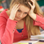stressed female teenage student studying in classroom stock photo © monkey_business