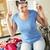 nő · ül · konyhapult · szennyeskosár · nők · boldog - stock fotó © monkey_business